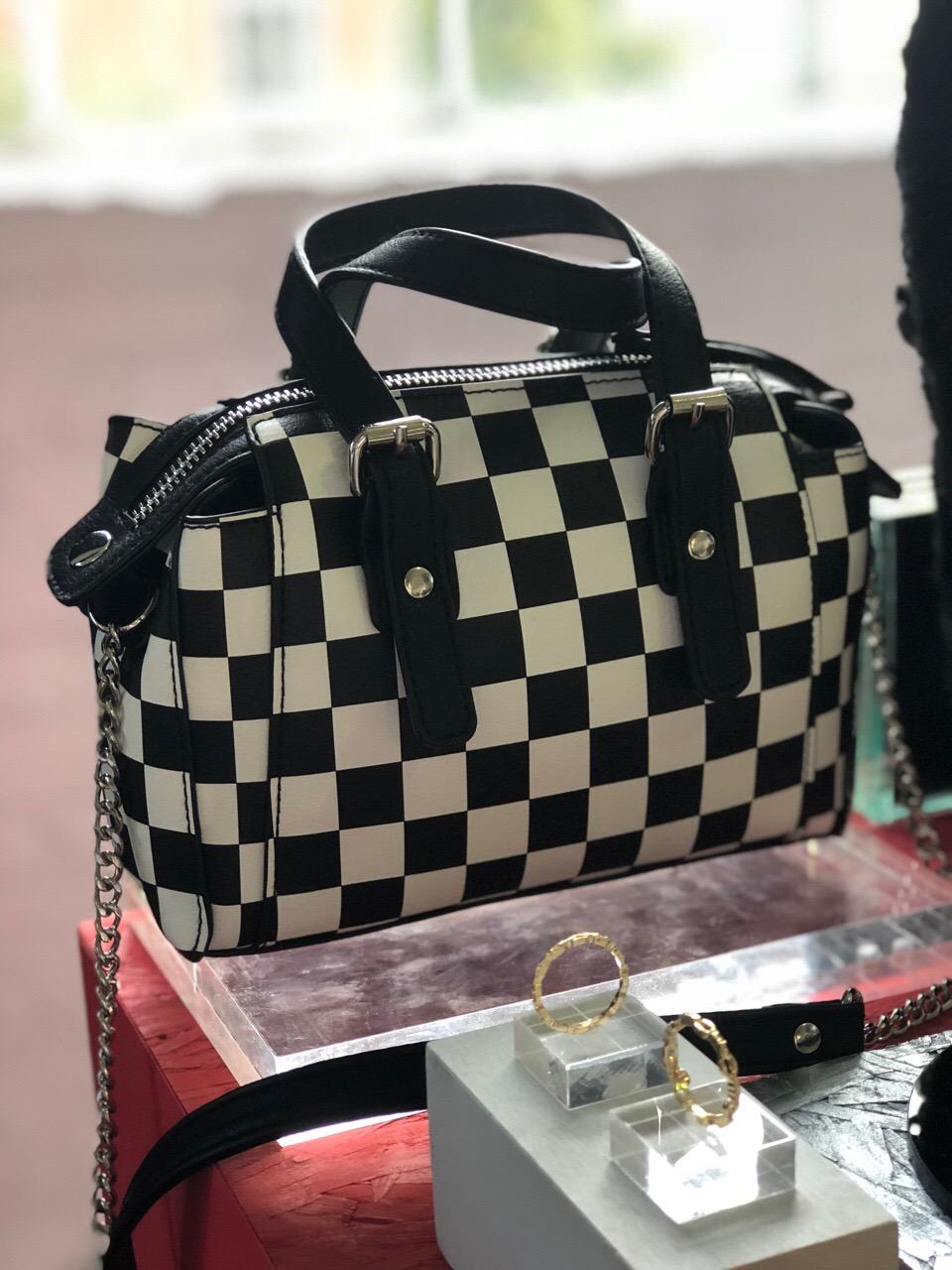 6f0b2a40aa4 This checkerboard mini crossbody bag is definitely a wardrobe want